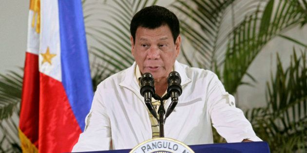 Philippines' President Rodrigo Duterte delivers his pre-departure message before leaving for the Association...