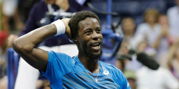 Gael Monfils, of France, reacts after beating Lucas Pouille, of France, during the quarterfinals of the...
