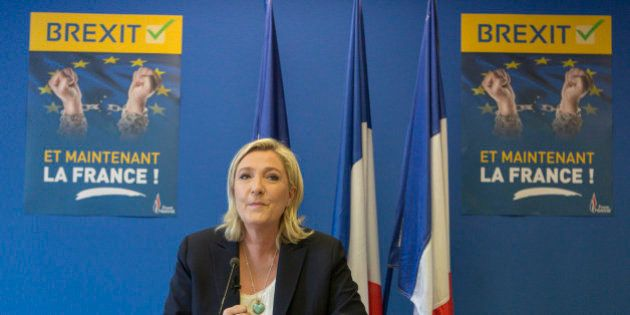French far-right leader Marine Le Pen speaks during a press conference at the National Front party headquarters...