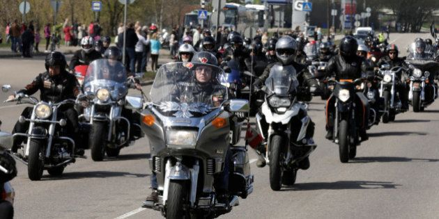 Bikers on their motorcycles ride during the annual biking season's opening parade in Riga, Latvia, April...
