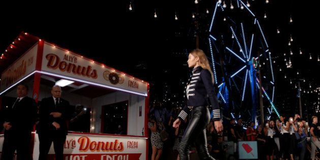 Model Gigi Hadid presents a creation from the Tommy Hilfiger Spring/Summer 2017 collection at New York...