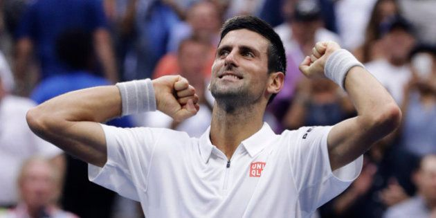 Novak Djokovic, of Serbia, reacts after defeating Gael Monfils, of France, during the semifinals of the...