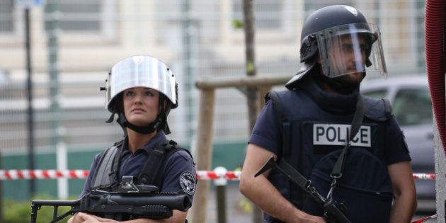 French police secure a street as members of special forces carried out counter-terrorism swoop at different...