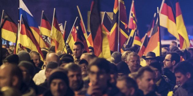 People hold flags in Erfurt, central Germany, Wednesday, March 16, 2016, during a demonstration initiated...