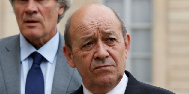French Defence minister Jean-Yves Le Drian (R) and Agriculture Minister and Government spokesperson Stephane...