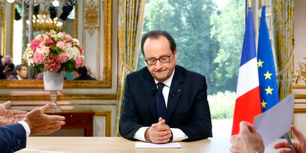 French President Francois Hollande reacts after a televised interview at the Elysee Palace where he said...