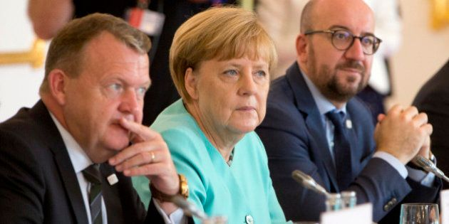 German Chancellor Angela Merkel, center, listens to the opening remarks at an EU summit at Bratislava...