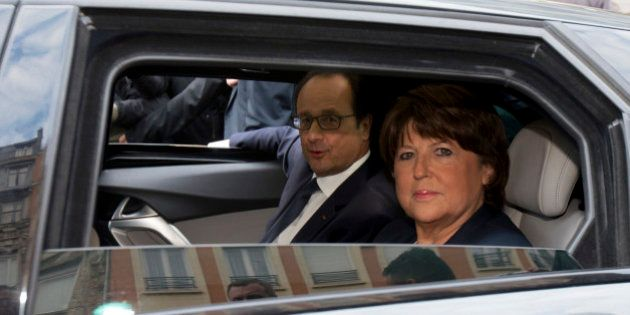 Lille's Mayor Martine Aubry (R) and French President Francois Hollande (L) sit in a car as they leave...