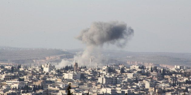 Smoke rises after airstrikes by pro-Syrian government forces in Anadan city, about 10 kilometers away...