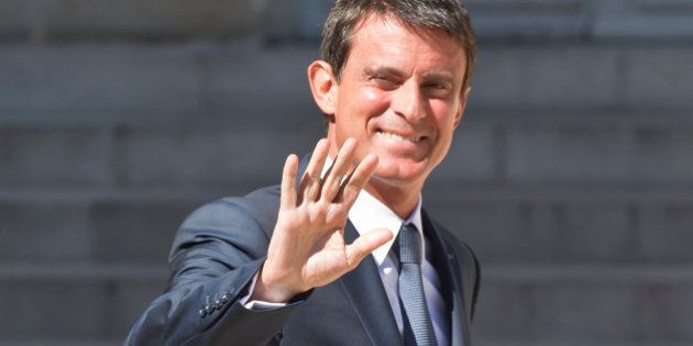 French Prime Minister Manuel Valls waves t the media after the first cabinet meeting since the summer...
