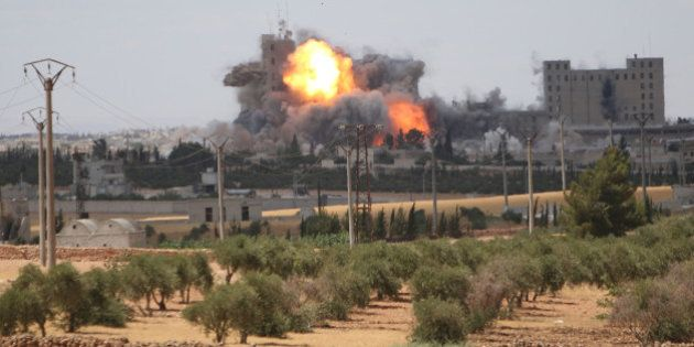Smoke and flame rise after what fighters of the Syria Democratic Forces (SDF) said were U.S.-led air...