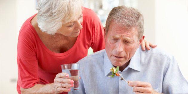 Senior woman looking after sick husband
