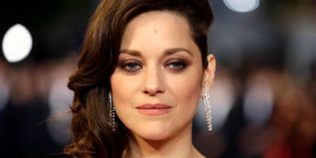 FILE - In this May 19, 2016 file photo, actress Marion Cotillard poses for photographers upon arrival...