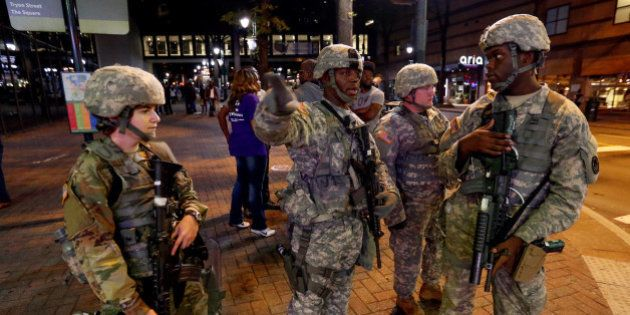 National Guard troops are pictured as they are deployed throughout the city during a protest against...
