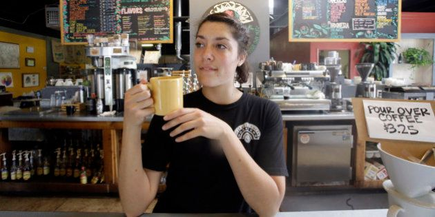 Barista Eviana Dan drinks a cup of coffee at Millcreek Coffee Roasters during National Coffee Day, Tuesday,...