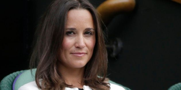 Pippa Middleton, the sister of Britain's Catherine, Duchess of Cambridge, watches the women's singles...