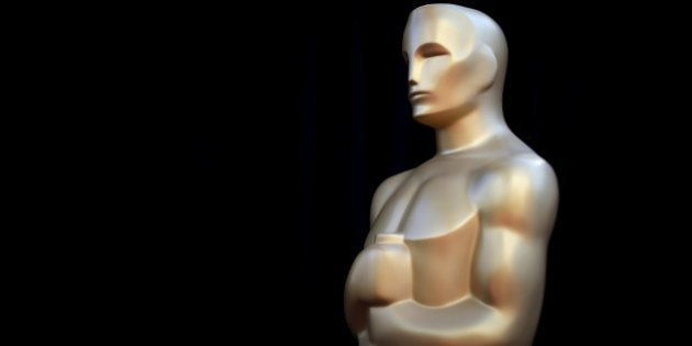 An Oscar statue stands on the red carpet at the entrance to the Dolby Theatre as preparations continue...