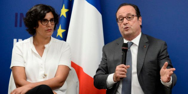 French President Francois Hollande delivers his speech next to Labour minister Myriam El Khomri as he...