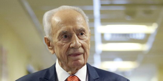 Former Israeli President Shimon Peres delivers a statement to the media as he is discharged from a hospital...