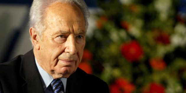 Labour Party leader Shimon Peres attends his party's conference in Tel Aviv, December 12, 2004. REUTERS/Nir...