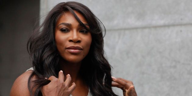 U.S. tennis star Serena Williams poses for photographers prior to the start of the Giorgio Armani women's...