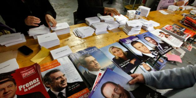 Civil servants prepare electoral documents for the upcoming French presidential election in Nice, April...