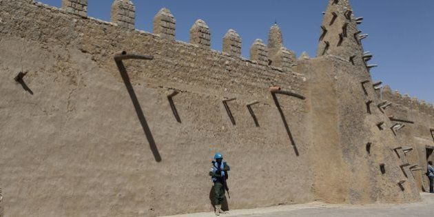 A UN peacekeeper walks next to the Djingareyber mosque on February 4, 2016 in Timbuktu. Mali's fabled...