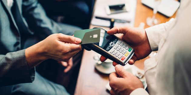 Close up of a card payment being made betweem a man and a waiter in a