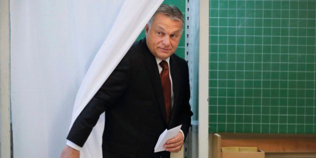 Hungarian Prime Minister Viktor Orban exits a voting cabin after voting in the referendum in Budapest,...