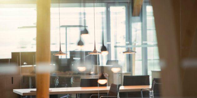 Light fixtures and desks in empty office