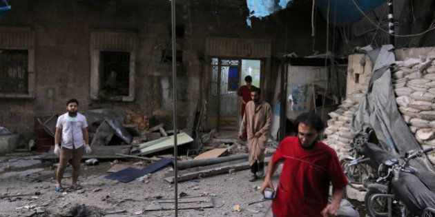 Medics inspect the damage outside a field hospital after an airstrike in the rebel-held al-Maadi neighbourhood...