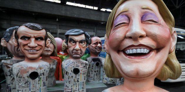 Des figures géantes de Marine Le Pen, François Fillon et Emmanuel Macron, candidats à l'élection présidentielle...