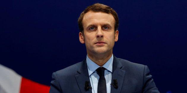 Macron a bien un programme, rangé dans un classeur gris. REUTERS/Jean-Paul