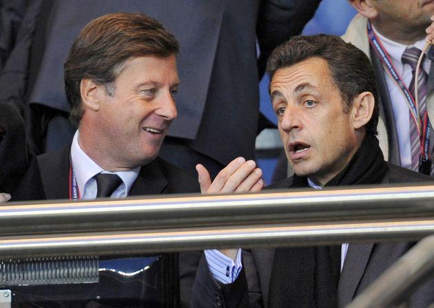 Paris-Saint-Germain football club's president Sebastien Bazin (L) chats with French president Nicolas...