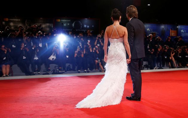 Actors Penelope Cruz and Javier Bardem pose during a red carpet event for the movie