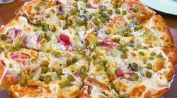 Sur Twitter, cette pizza mayonnaise/petits-pois a écœuré les