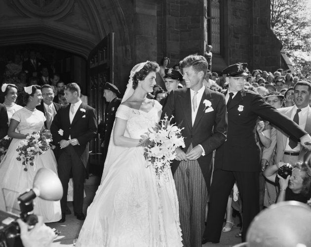 Senator John F. Kennedy and his bride, the former Jacqueline Lee Bouvier, leave a Newport, Rhode Island,...