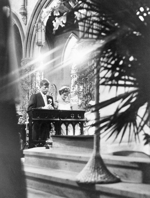 (Original Caption) 1953-Newport, RI: Striking portrait of John Kennedy and Jacqueline Bouvier kneeling...