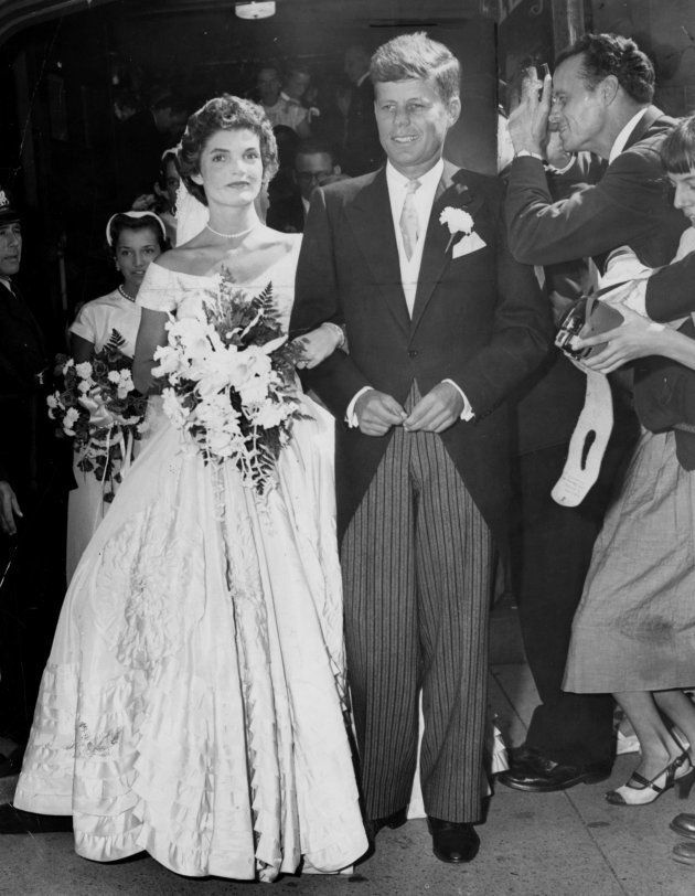 NEWPORT, RI - SEPTEMBER 12: John F. Kennedy and Jacqueline Kennedy outside St. Mary's Church after their...