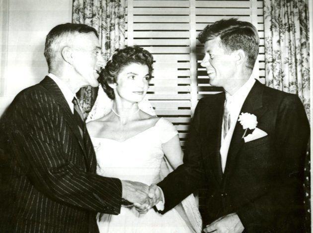 NEWPORT, RI - SEPTEMBER 12: Senator Leverett Saltonstall congratulates Sen. John F. Kennedy at the wedding...