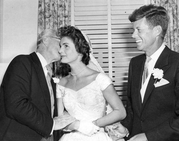 NEWPORT, RI - SEPTEMBER 12: Senator John F. Kennedy, right, smiles as his father, Joseph P. Kennedy Sr.,...