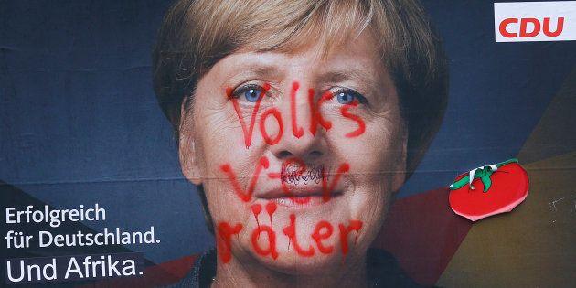 Une affiche de campagne de la CDU, montrant un portrait d'Angela Merkel et le
