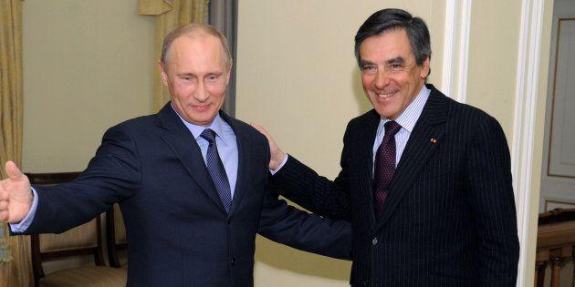 Vladimir Poutine et François Fillon à Moscou, le 21 mars 2013. (AP Photo/RIA-Novosti, Alexei Druzhinin,...