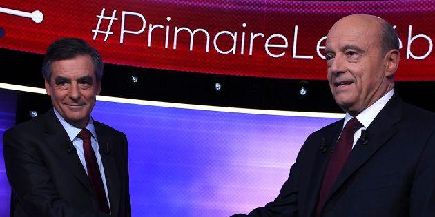 Alain Juppe et Francois Fillon se serrent la main quelques minutes avant le débat d'entre-deux-tours...