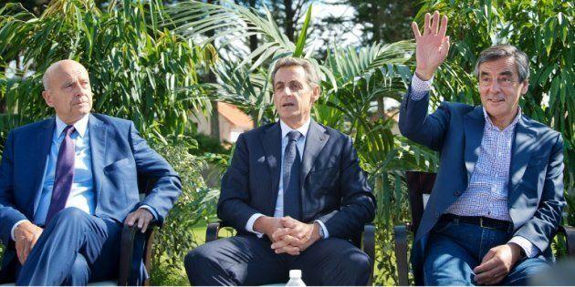 Alain Juppé, Nicolas Sarkozy et Francois Fillon en septembre 2015 à La Baule. AFP PHOTO / JEAN-SEBASTIEN...