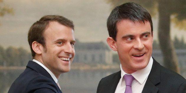 Manuel Valls et Emmanuel Macron, le 7 mai 2014, au Palais de l'Elysée. REUTERS/Christian Hartmann (FRANCE...