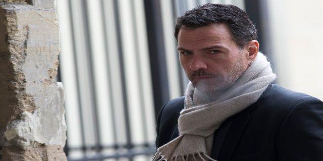 Jérôme Kerviel sort de la cour d'appel de Versailles, le 29 janvier 2016. / AFP PHOTO / KENZO