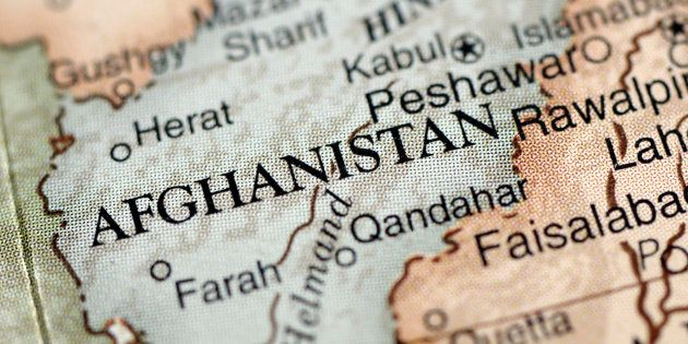 A close-up photograph of Afghanistan from a desktop globe. Adobe RGB color
