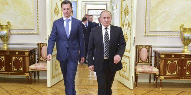 Vladimir Poutine et Bachar Al-Assad durant une rencontre au Kremlin à Moscou en Russie, le 20 octobre