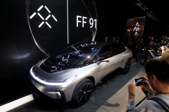 A Faraday Future FF 91 electric car is displayed on stage during an unveiling event at CES in Las Vegas,...